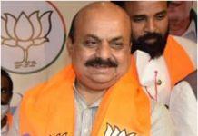 Bommai takes oath as Karnataka CM: Blessed by touching Yeddyurappa's feet